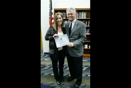 Mrs. Roehl with Superintendent holding certificate